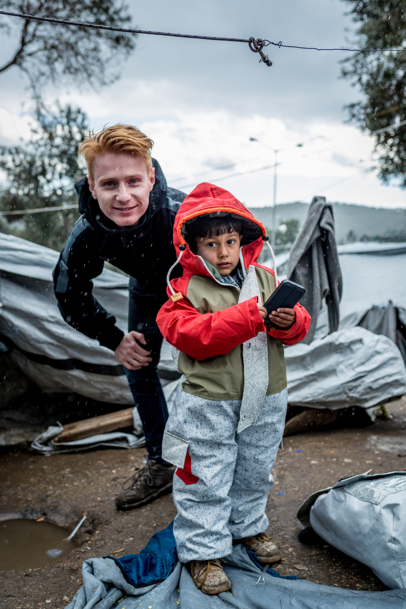 Bas Timmer at Lesbos distributing Sheltersuits to refugee children